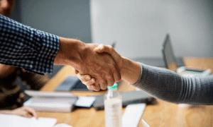 sopimus kättely neuvottelu yhteistyö talous